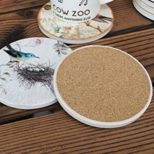 Ships from Hong Kong. Impress your guests with this elegant set of placemat that are perfect for everyday use. Very durable and easy to clean. Material: ceramic + cork wood. Diameter: 11 cm ( 4.3 Inch ). Durable